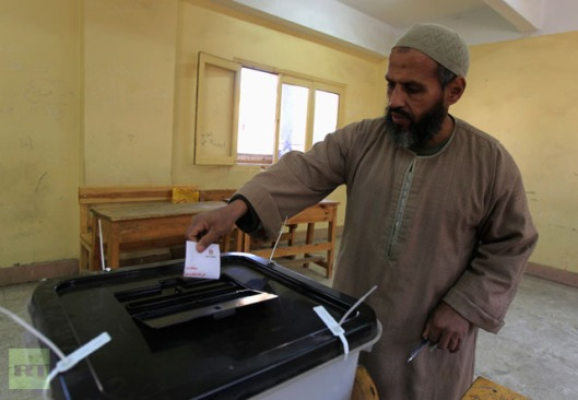 An Egyptian voter casts his ballot in the referendum