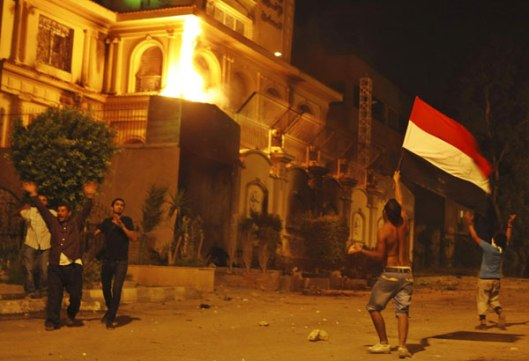 Protesters outside the besieged Muslim Brotherhood headquarters