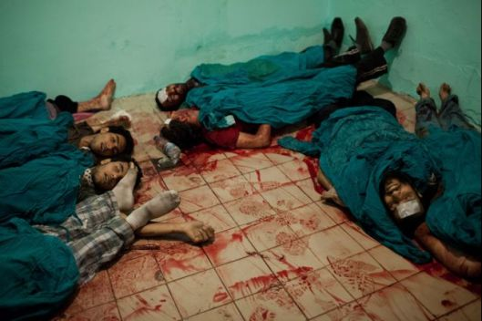 Bodies fill the makeshift morgue following the massacre