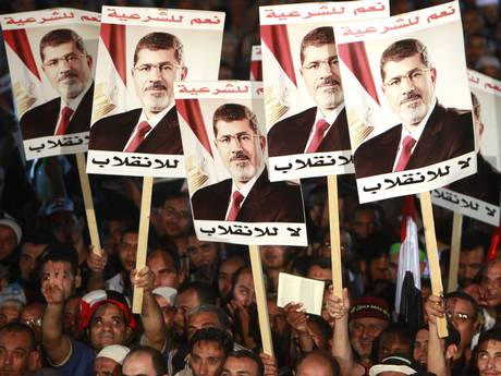 Supporters of Mr Morsi